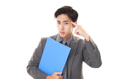 Dissatisfied Asian businessman Stock Images