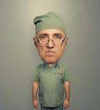 Dissatisfied bighead doctor in uniform Stock Image