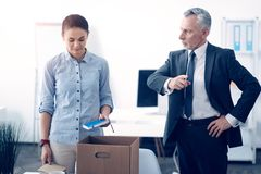 Dissatisfied boss firing young office worker Royalty Free Stock Photography