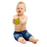 Dissatisfied boy disclaims pears on a white background Stock Photo