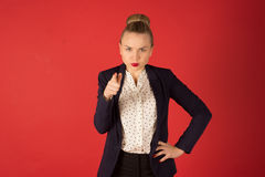 Dissatisfied business woman. On a red background Stock Photography