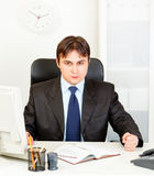 Dissatisfied businessman banging fist on table Stock Photography