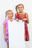 Dissatisfied children girls holding paper Royalty Free Stock Photo