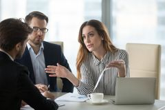 Dissatisfied executive having conflict with employee about financial report mistake. Dissatisfied executive manager having conflict with employee about financial stock images