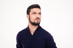 Dissatisfied frowning handsome young man with beard in sweetshirt Stock Photo