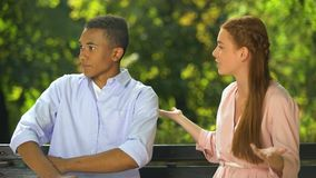 Dissatisfied girl making complaint to her shocked boyfriend, relationship crisis. Stock footage stock footage