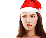 Dissatisfied girl in Santa's hat Stock Image