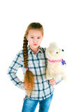Dissatisfied girl with a toy puppy an armpit Royalty Free Stock Photos