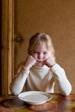 Dissatisfied Girl With Porridge Plate Royalty Free Stock Photo