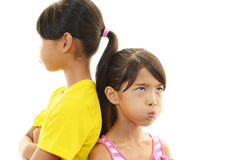 Dissatisfied girls. Dissatisfied Asian girls on white background royalty free stock image