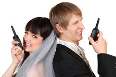 Dissatisfied groom and bride speak on radio Stock Photography