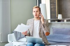 Discontent Freelancer Using Mobile Phone Stock Photography