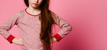 Dissatisfied little girl in pajamas woke up and angry for you royalty free stock photo
