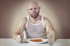 Dissatisfied Man on Diet Stock Photo