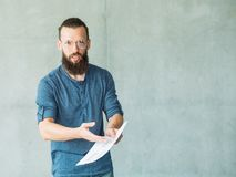 Dissatisfied man documents mistake business papers royalty free stock images