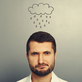 Dissatisfied man with drawing storm cloud Stock Image