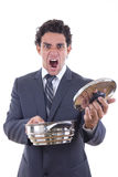 Dissatisfied man holding pot for cooking with expression Royalty Free Stock Photography