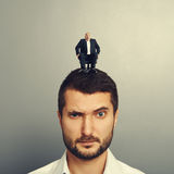 Dissatisfied man with small man Stock Photo