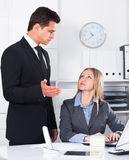 Dissatisfied manager scolding assistant Royalty Free Stock Photo