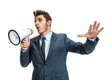 Dissatisfied manager screaming into a megaphone Royalty Free Stock Image