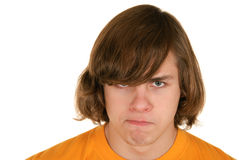 Dissatisfied teenager. On white background Stock Photography