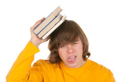 Dissatisfied teenager with book. On white background Stock Photo