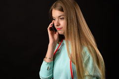 Dissatisfied teenager girl talking on mobile phone Royalty Free Stock Image