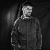 Dissatisfied welder in black boilersuit Royalty Free Stock Photo