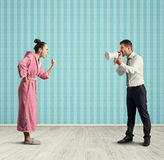 Dissatisfied wife and angry husband Stock Image