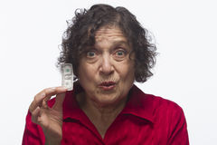 Dissatisfied woman holds dollar bill, horizontal. Older woman holding her nest egg, horizontal Royalty Free Stock Images