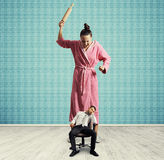 Dissatisfied woman with rolling pin Stock Photo