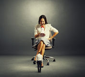 Dissatisfied woman sitting Royalty Free Stock Images