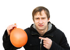Dissatisfied young man hold a balloon Royalty Free Stock Images