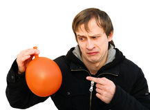 Dissatisfied young man hold a balloon Royalty Free Stock Photo