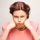 Dissatisfied young woman Royalty Free Stock Images