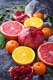 Dissected fresh fruits. Pomegranate, orange, grapefruit and tang Royalty Free Stock Photo