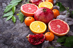 Dissected fresh fruits. Pomegranate, orange, grapefruit and tang. Erines. Selective focus Stock Photography