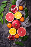 Dissected fresh fruits. Pomegranate, orange, grapefruit and tang Royalty Free Stock Photography