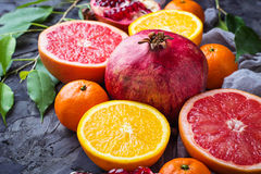 Dissected fresh fruits. Pomegranate, orange, grapefruit and tang Stock Image