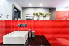 Dissipador do banheiro no vermelho Imagem de Stock Royalty Free