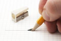 Dissipare una riga con la matita Immagini Stock