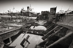 Dissolved ship. Black and white photo of a dissolved ship in a scrap yard Stock Photography