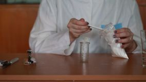 Dissolving the powder in water and mixing stock video