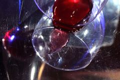 The bottled wine. The fallen glass. Dissonance. The bottled wine. The fallen glass. Blue color and red wine. Incongruous, unsuitable colors Royalty Free Stock Image