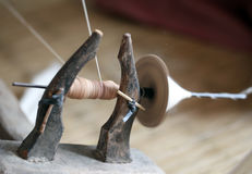Distaff, spinning yarn on spinning wheel Stock Images