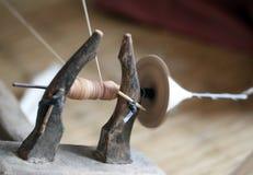 Distaff, spinning yarn on spinning wheel Stock Images