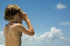 In the distance. Young boy looking in the distance. Room for text royalty free stock photo