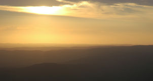 Distance. Aerial of sunset over mountain ranges Royalty Free Stock Photo
