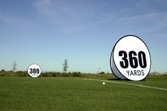 Distance is King. Several golf balls showcase the power and distance of the Players Tour Long drive hitters Royalty Free Stock Image