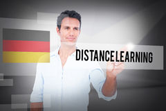 Distance learning against abstract white room. The word distance learning and handsome man making gun gesture against abstract white room Royalty Free Stock Photos